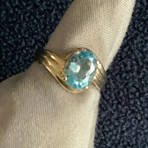 14K Oval Cut Swiss Blue Topaz Ring